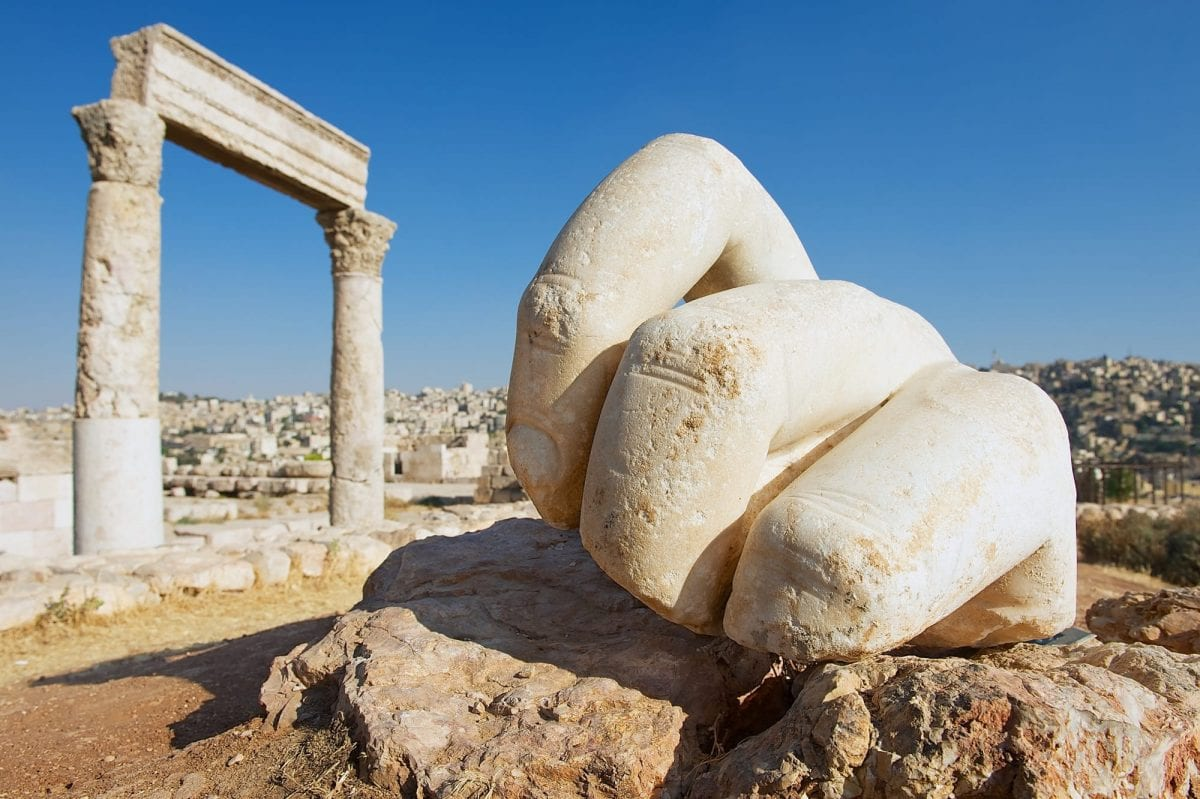 Stone Hercules hand at the antique citadel in Amman Jordan by Dmitry Chulov