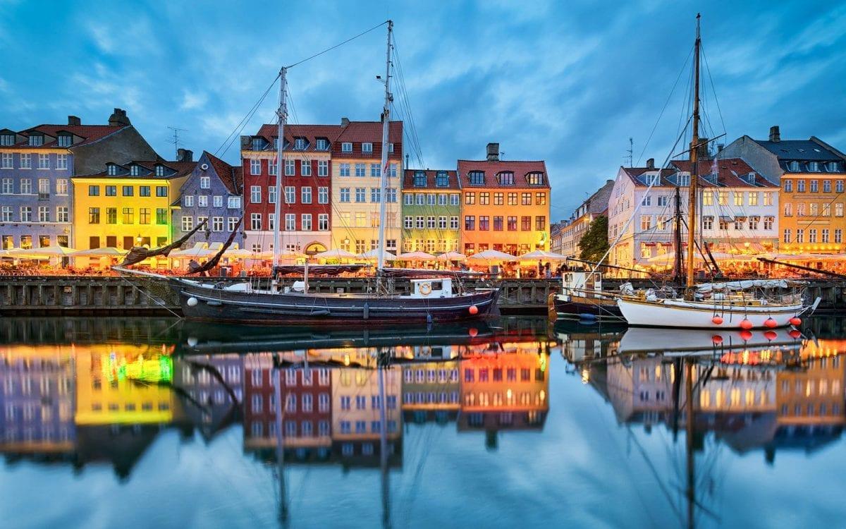 Nyhavn in Copenhagen, Denmark at night; Shutterstock