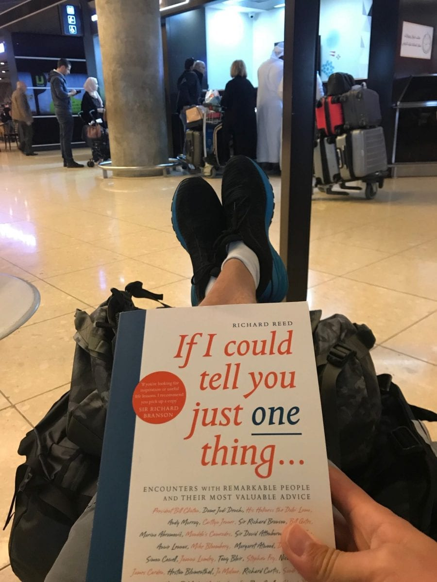 Waiting means reading while charging your phone at Amman airport